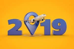 Vector image of 2019 with an airplane flying through the letter 'O'