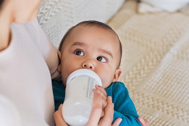 A baby feeding on milk.