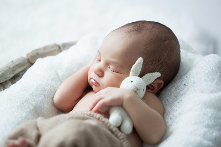 A baby boy fast asleep.