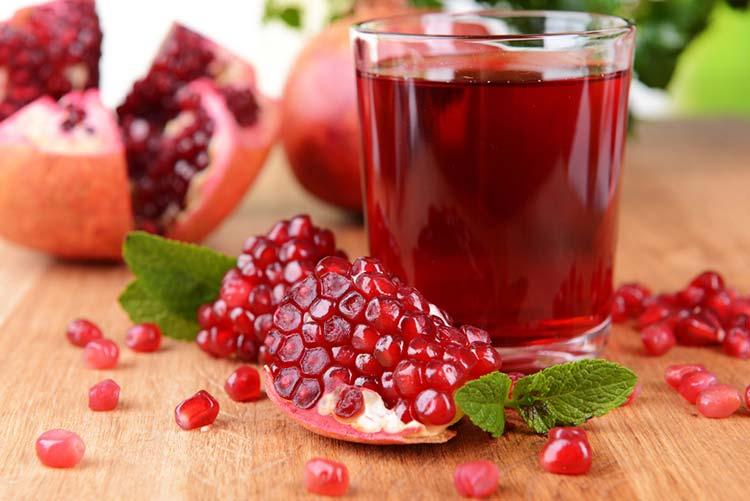 A glass of pomegranate juice.