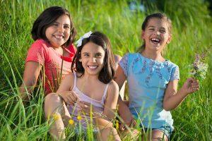 Three siblings enjoying a day at the park.