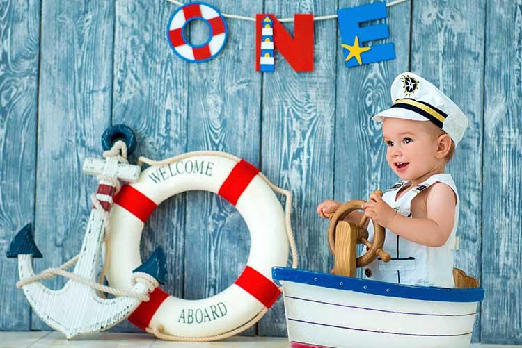 A baby boy enjoying is sailor's photoshoot.